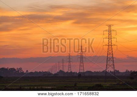 Electric pole at sunset twilight landscape background