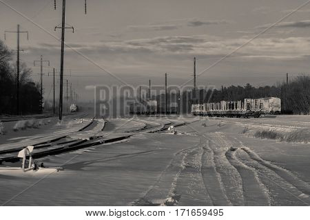 Rail Landscape. Snowing Bw