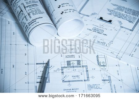 house blueprints, blue print style floor plans on architects desk, blueprint of a house from a high angle, blueprint of a house showed in perspective