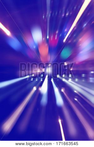 Abstract image of night lights in motion blur with zoom effect.