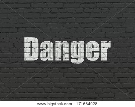 Privacy concept: Painted white text Danger on Black Brick wall background