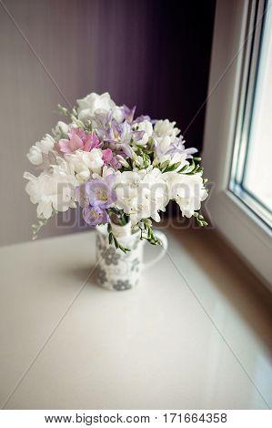 Wedding Boquet In Mini Vase On Purple Background