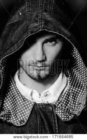 Portrait of man with hood looking at camera
