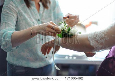 wedding boquet tie on hand bridal close up