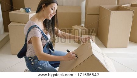 Attractive woman moving house and packing