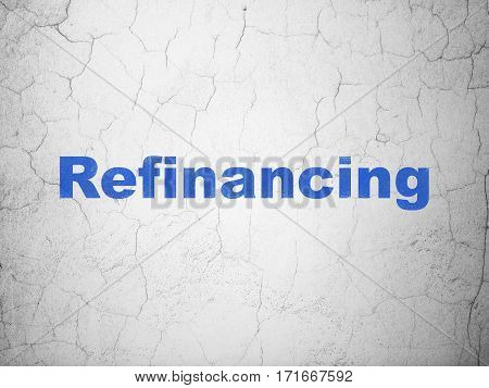 Business concept: Blue Refinancing on textured concrete wall background