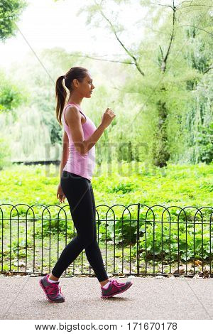 a fitness woman walking in the park