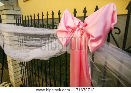The pink wedding decorations on the street