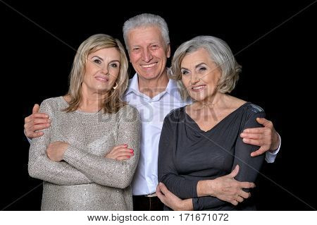 mature women and man on black background