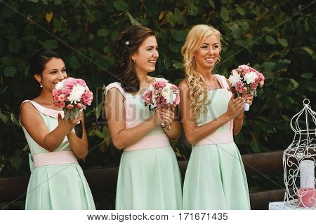 The bridesmaids clapping on the wedding ceremony
