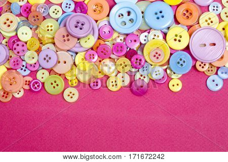 collection of a range of different coloured buttons for a poster or web background