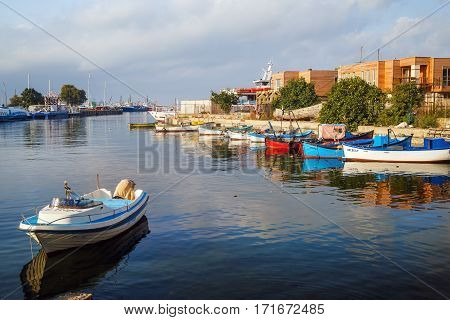 Nesebar Bulgaria - September 05 2014: Fishing boats at the pier in the harbor of the old town of Nessebar Bulgaria. Old Nesebar is an ancient town on the Bulgarian Black Sea Coast.