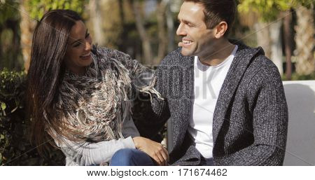 Happy young couple enjoying the autumn sunshine