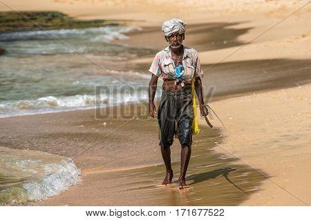 Weligama, Sri Lanka -  January 18, 2017:  Portrait Of Local Fisherman Sitting On Boat. Tourism And F