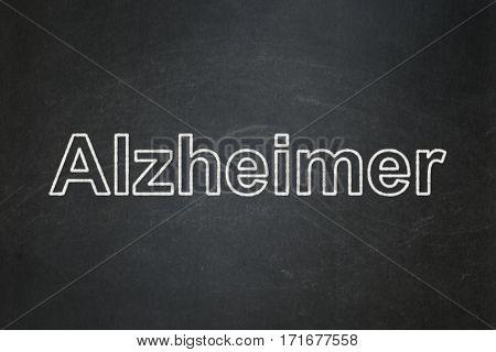 Health concept: text Alzheimer on Black chalkboard background