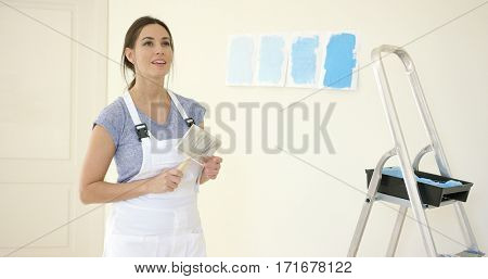 Attractive capable woman redecorating her home