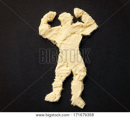 Bodybuilder's figure from protein powder. Sport supplements concept.