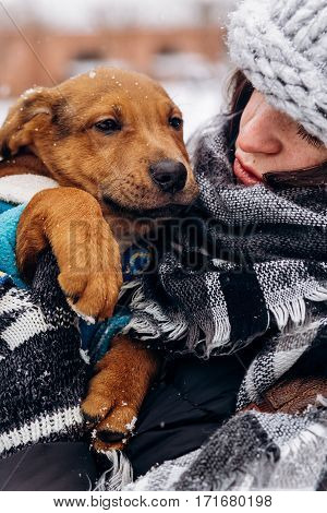 Stylish Hipster Girl Hugging Cute Puppy In Snowy Cold Winter Park. Moments Of True Happiness. Adopti