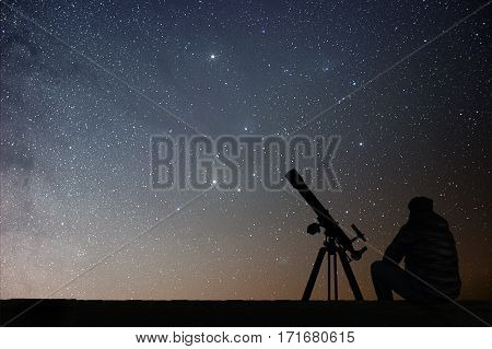 Man With Astronomy  Telescope Looking At The Stars.
