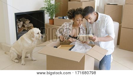 Golden retriever watching his owners pack