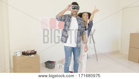 Man using virtual reality glasses gets help