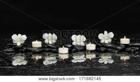 Set of white orchid ,candle with therapy stones