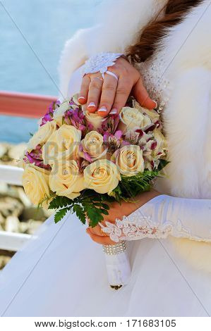 The Bride Holding Wedding Bouquet Of Pink And White Roses