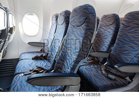 Interior of empty ready to fly airliner cabin with rows of seats