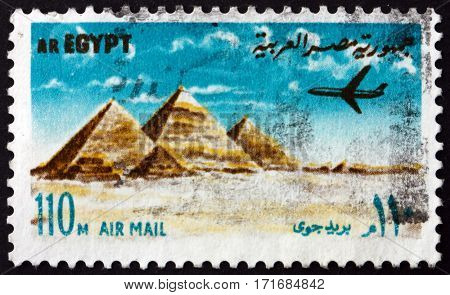EGYPT - CIRCA 1972: a stamp printed in Egypt shows Airplane over Giza pyramids circa 1972
