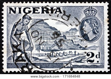 NIGERIA - CIRCA 1953: a stamp printed in Nigeria shows Mining tin circa 1953