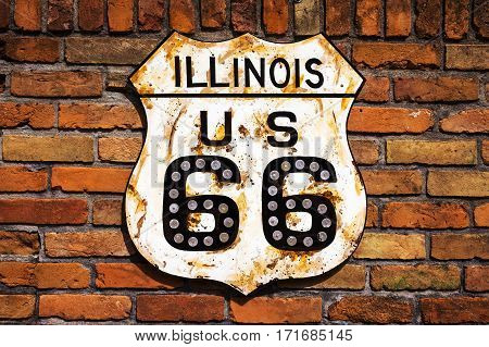 Rusty Route 66 Road Sign in a brick wall in the State of Illinois USA