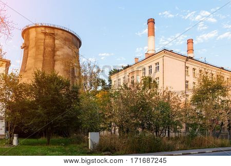 City cooling tower near the house and trees
