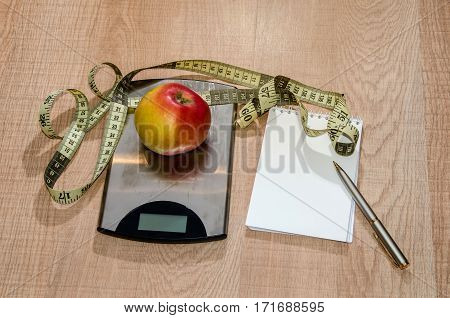 Healthy eating concept weight loss with fruit on wooden table blank copy space