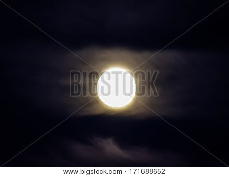 Moon In The Night Sky. Near The Moon A Small Amount Of Clouds