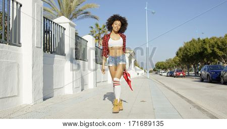 trendy young woman in skimpy denim shorts