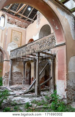 inside of ruined brick Catholic church close up