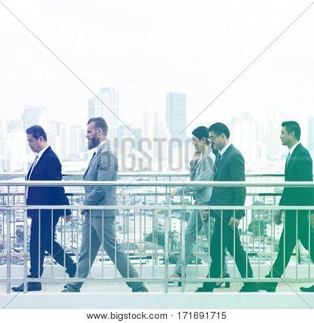 Business people walking over footbridge