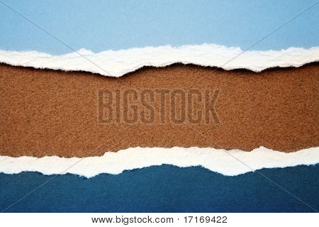 Ripped paper on brown background