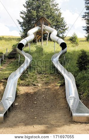 funny giant slide steel in the mountains