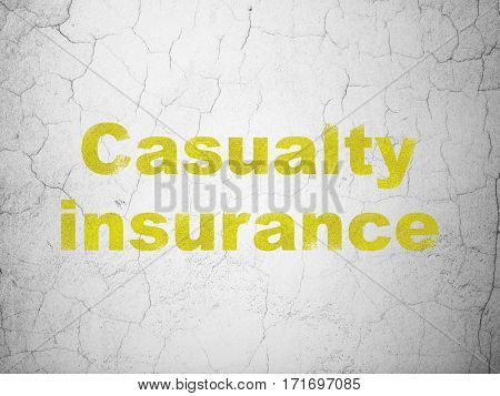 Insurance concept: Yellow Casualty Insurance on textured concrete wall background