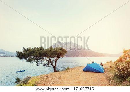 Blue tent on sandy wild beach at sunset light Turkey