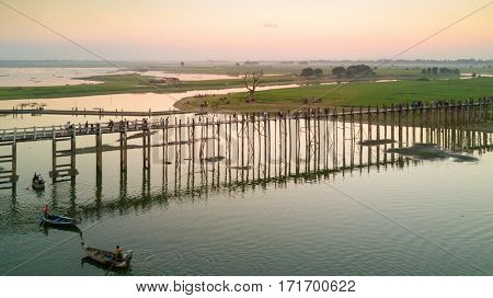 Aerial dusk view of the U-Bein bridge, in teak wood, Myanmar