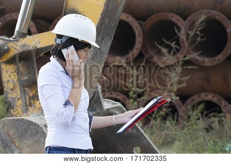 Woman engineer on site telephone call Selective focus and small depth of field