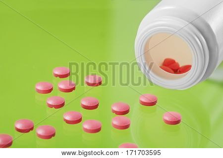 Pile Of Medical Pills And Bank On Glass Background