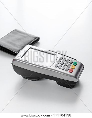 Present purchase in shop with payment by credit card on white table background