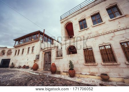 Old traditional Ottoman house in the background.
