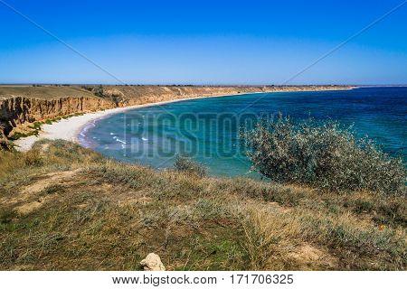 Beautiful sandy beach. Clear blue sea yellow sand and clear sky.