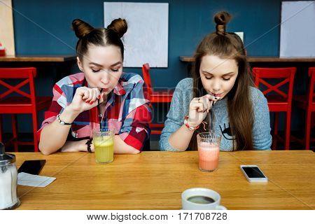 Young girls having fun in a cafe bar.