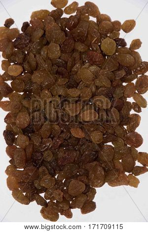 Raisin texture. golden raisin background dry sultana seeds vegetarian organic food
