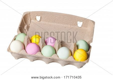 Colorful Easter eggs in a cardboard tray on white background, isolate, holiday concept